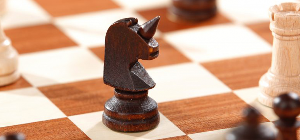 Unicorn chess piece on a chess board signifying strategy